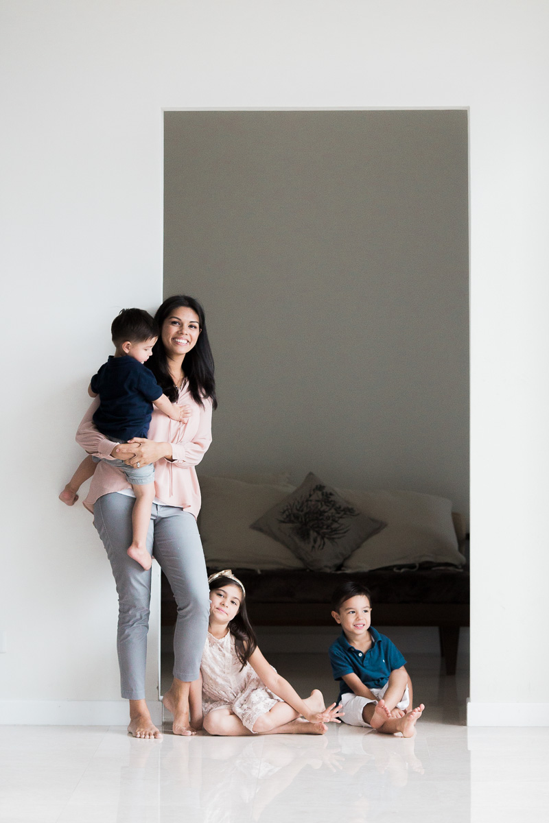 a mum and her three kids stand together in Kuala Lumpur by erica knecht, one of asia's top photographers.