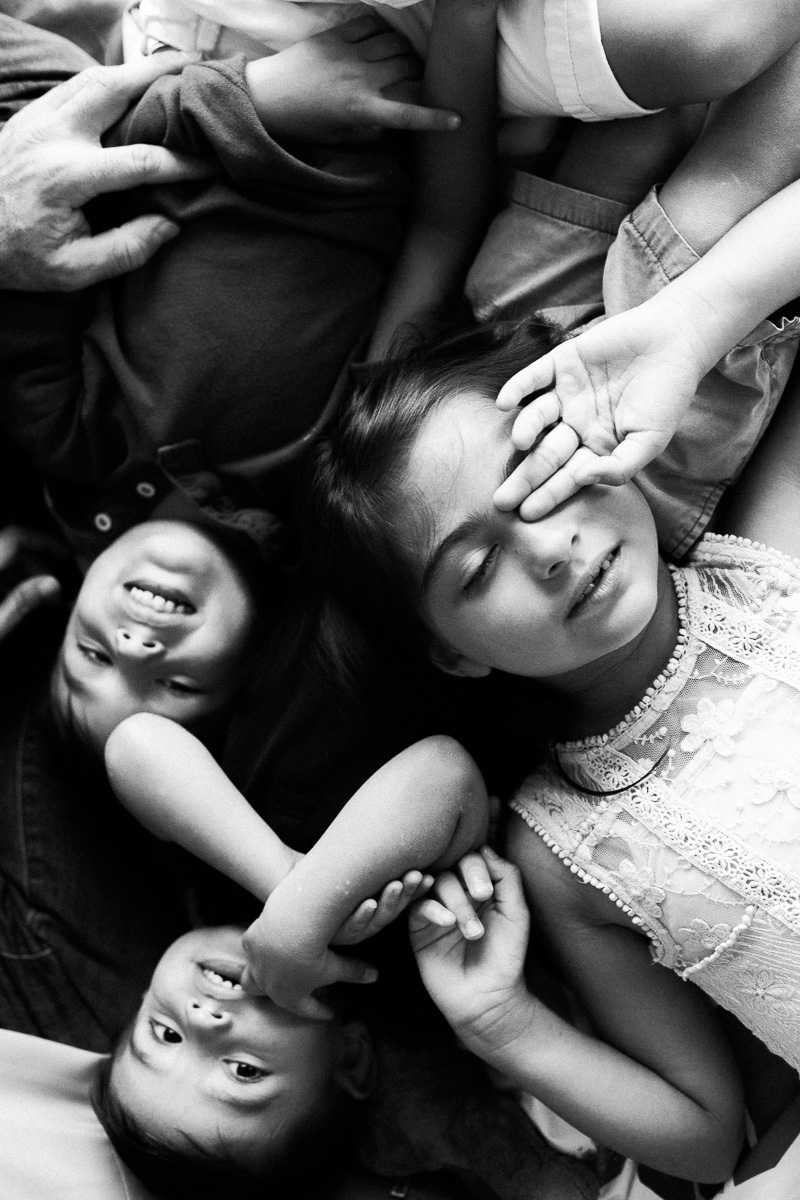 three children in black and white. A family photography session by one of asia's top photographer's erica kencht