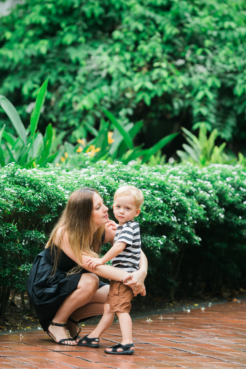Mum and son cuddle in KLCC park by Kuala Lumpur based family photographer Erica Knecht.