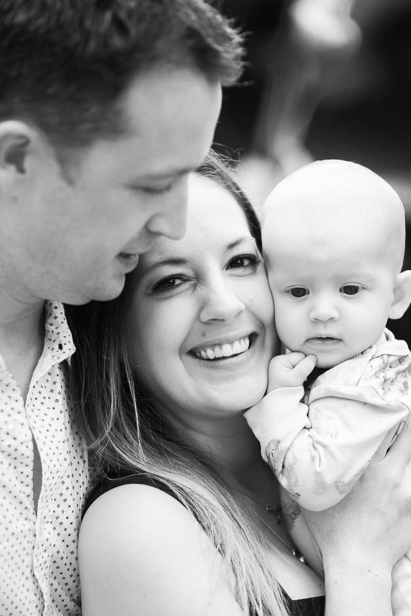 Dad and mum and baby in black and white by KL family photographer Erica Knecht.