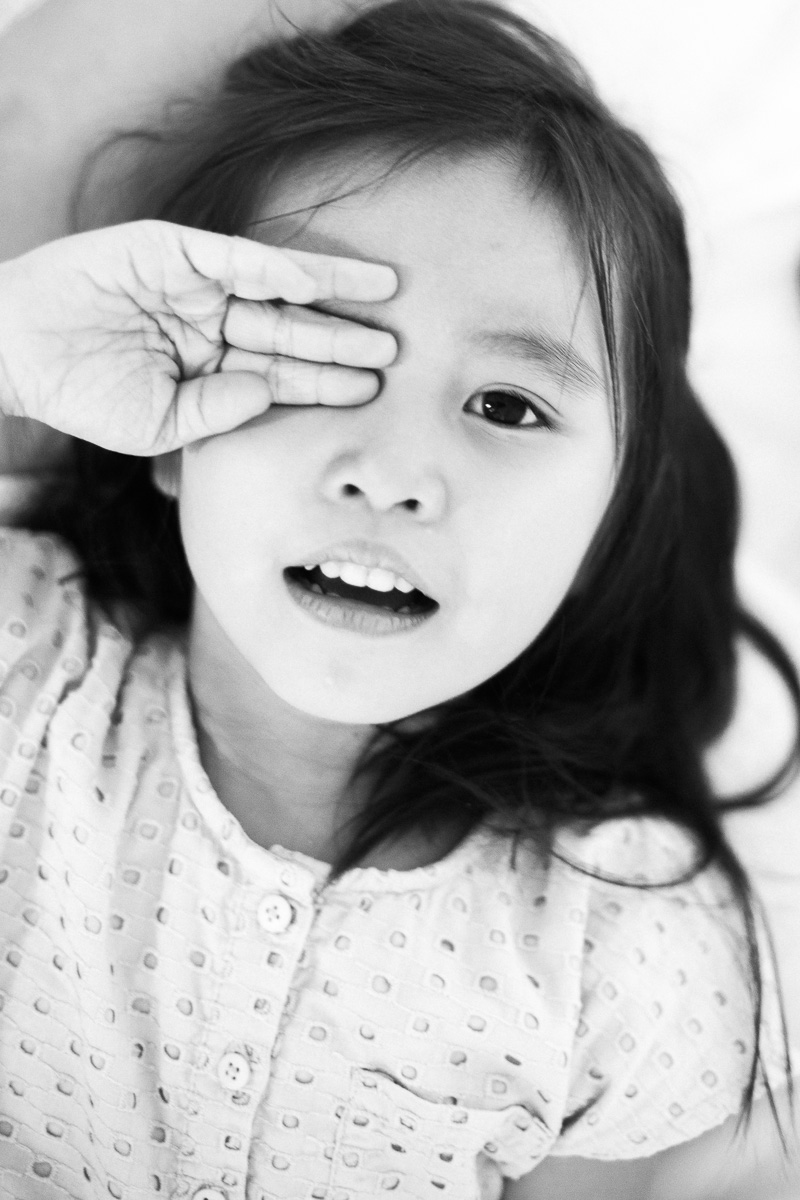 a black and white portrait of a little girl as shot by kuala lumpur family photographer erica knecht