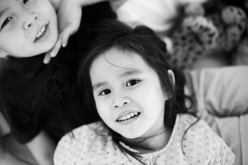 Black and white portraits of a brother and sister by Kuala Lumper Photographer Erica Knecht