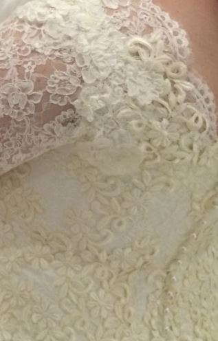 A close up of the lace detail from Victoria's bridal gown.