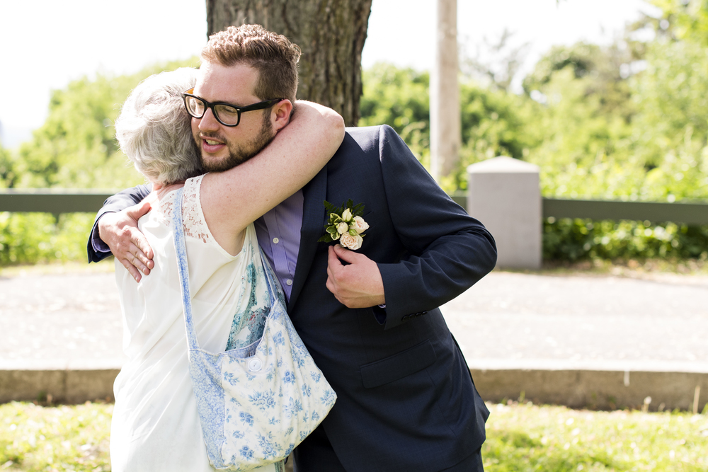 groom hugging mother