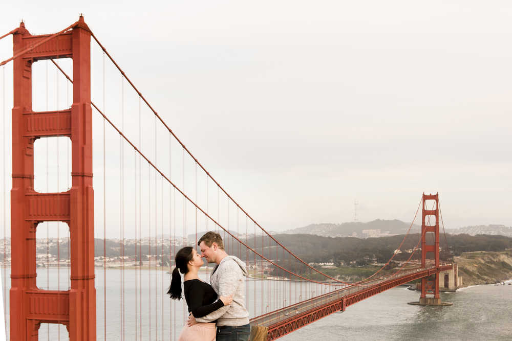 couple standing by bridge