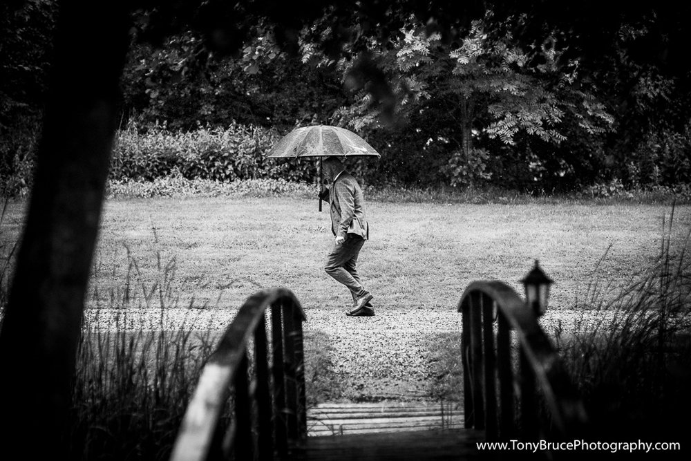 One of the groomsman dashes for his car in order to collect the Bride and her party as the heavens opened.
