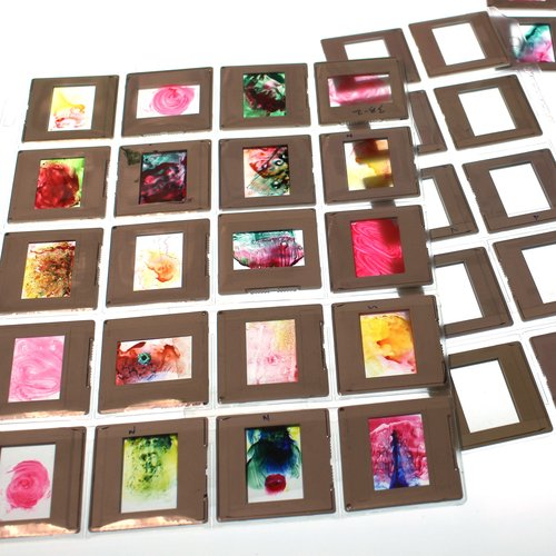 Slide Painting - Small paintings are created using recycled glass slides and High Flow acrylic paint.