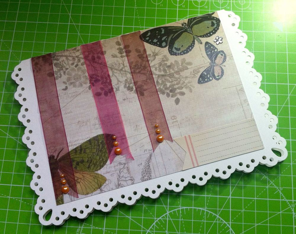 Adding embellishments to finish the anniversary card