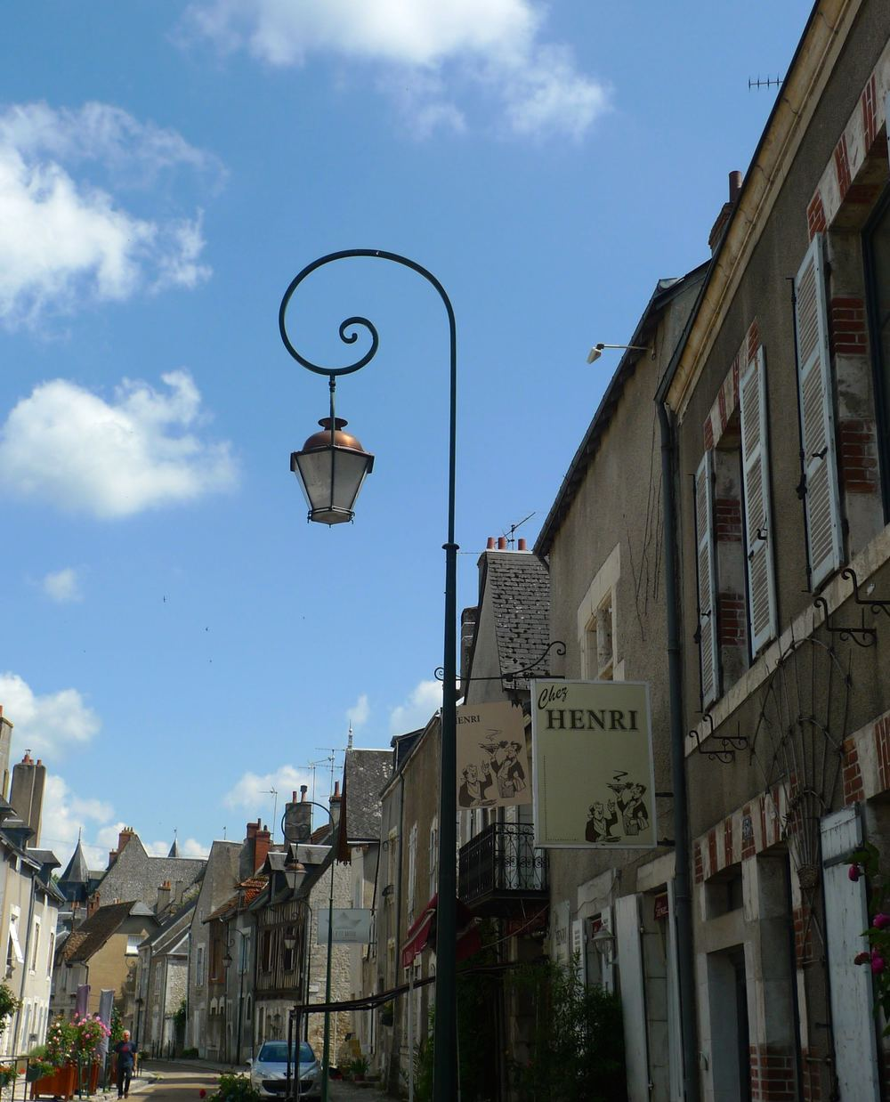 A lamp post with a curl
