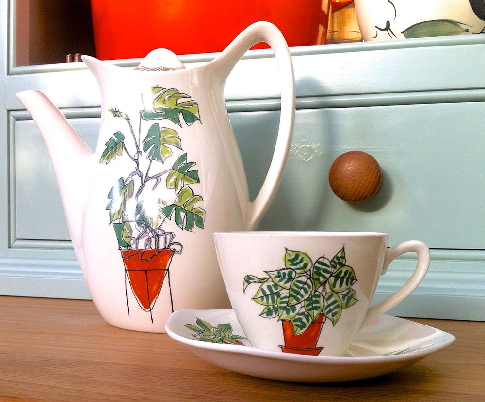 A coffee pot and cup and saucer