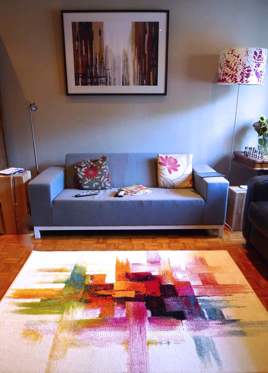 A portrait view of our main living space with new abstract rug which reminded me of our abstract print