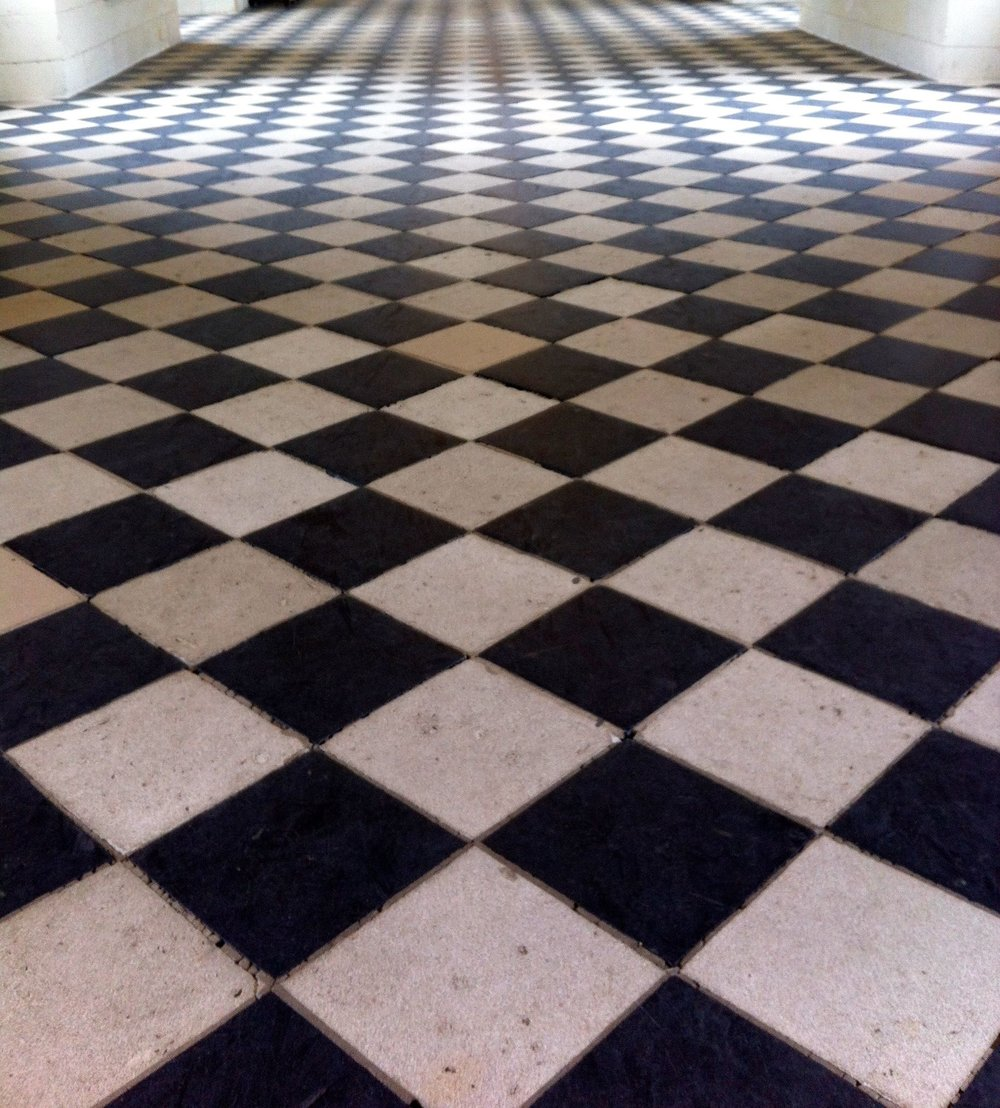 A close up of the chequered floor in the gallery at Chenonceau