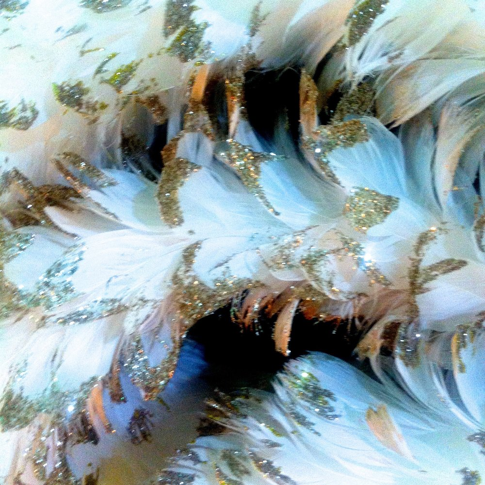 A close up of the feather wreath