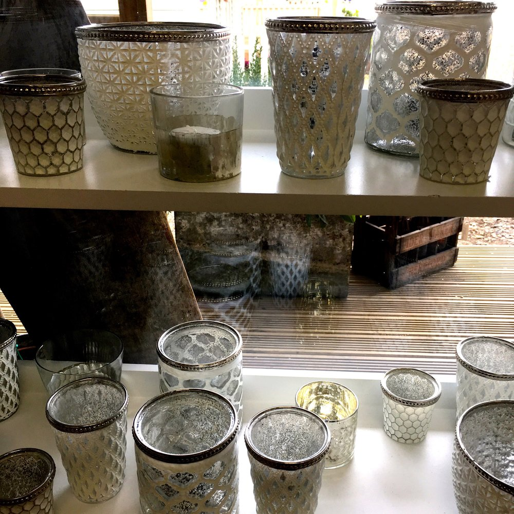 Shelves of glass vases