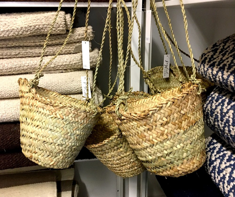 Natural materials hanging baskets and textural rugs
