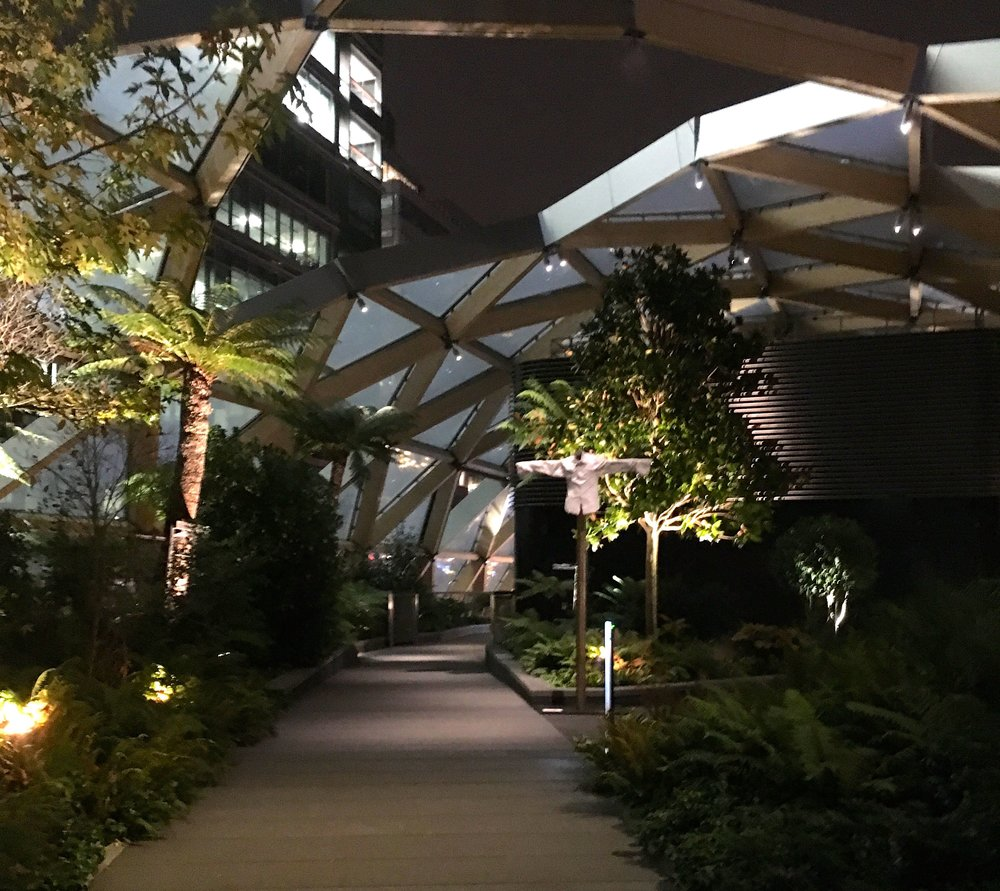 Admiring the roof garden in crossrail place in Canary Wharf at night