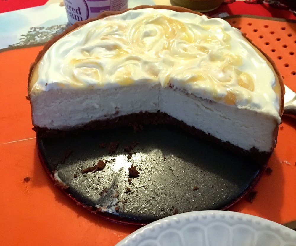 The lemon cheesecake part-way being served