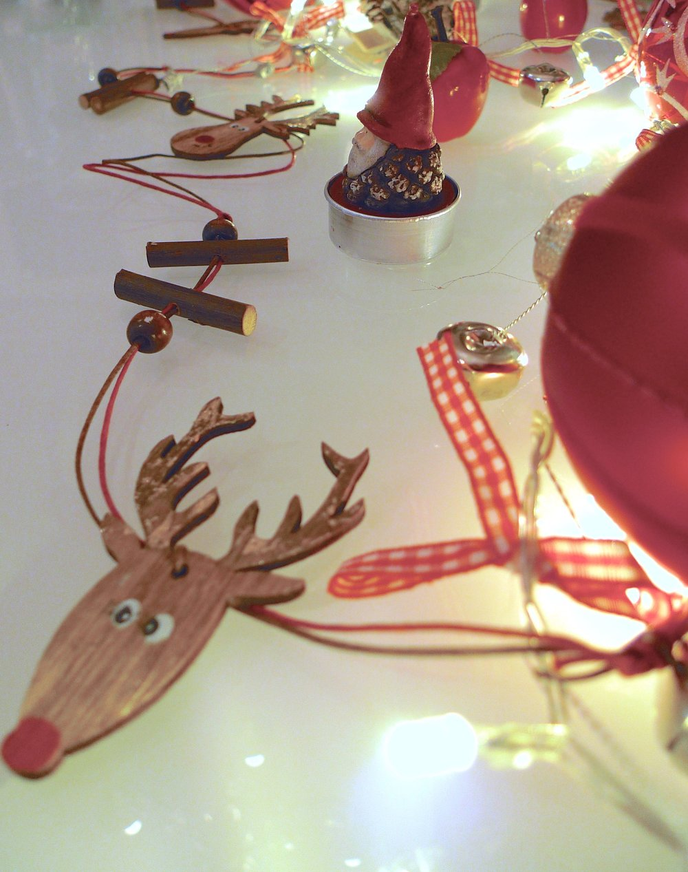 A cheeky reindeer garland among the jingle bell lights from TK Maxx