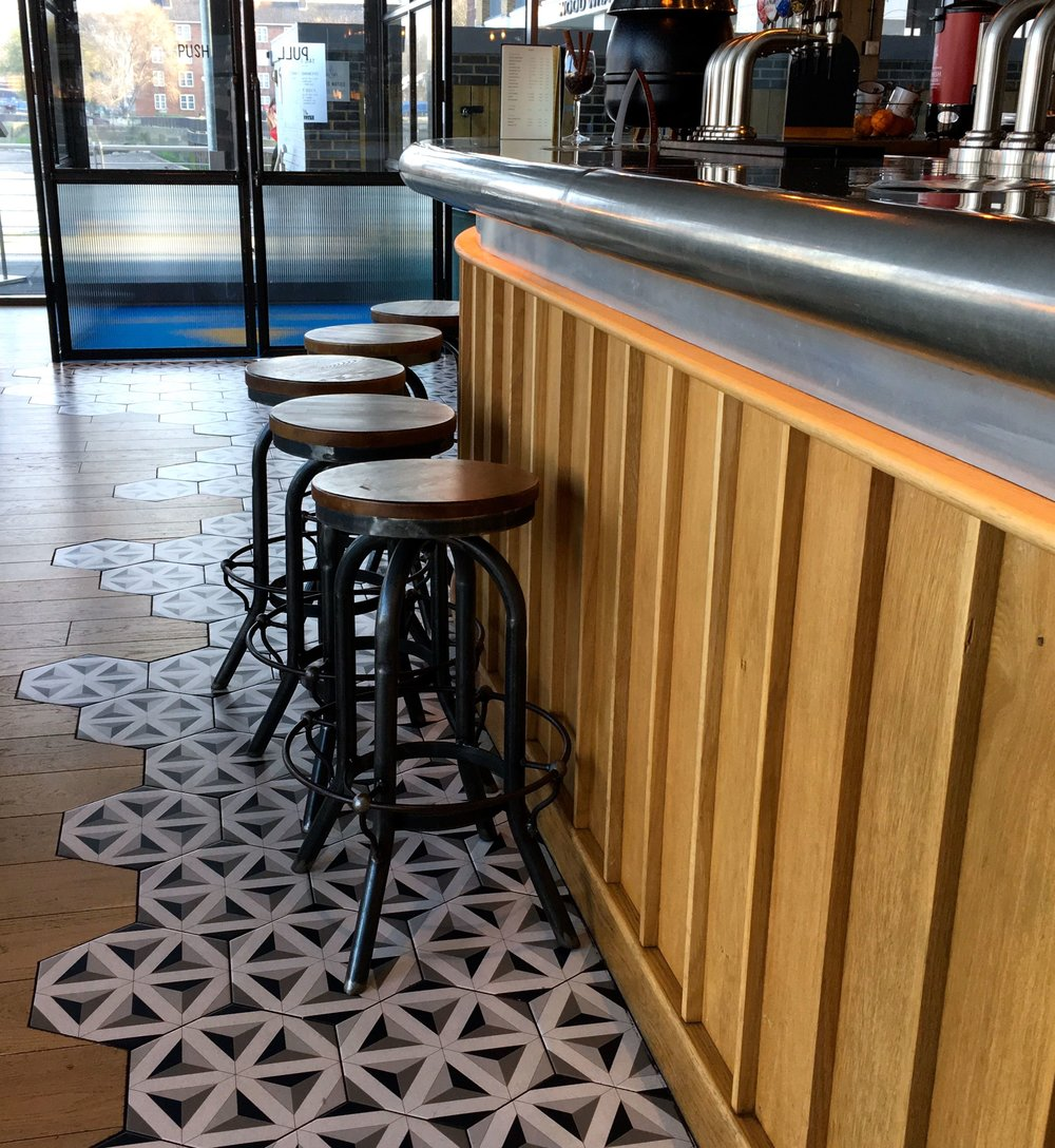 My first view of the industrial style bar and bar stools left me wanting to explore more