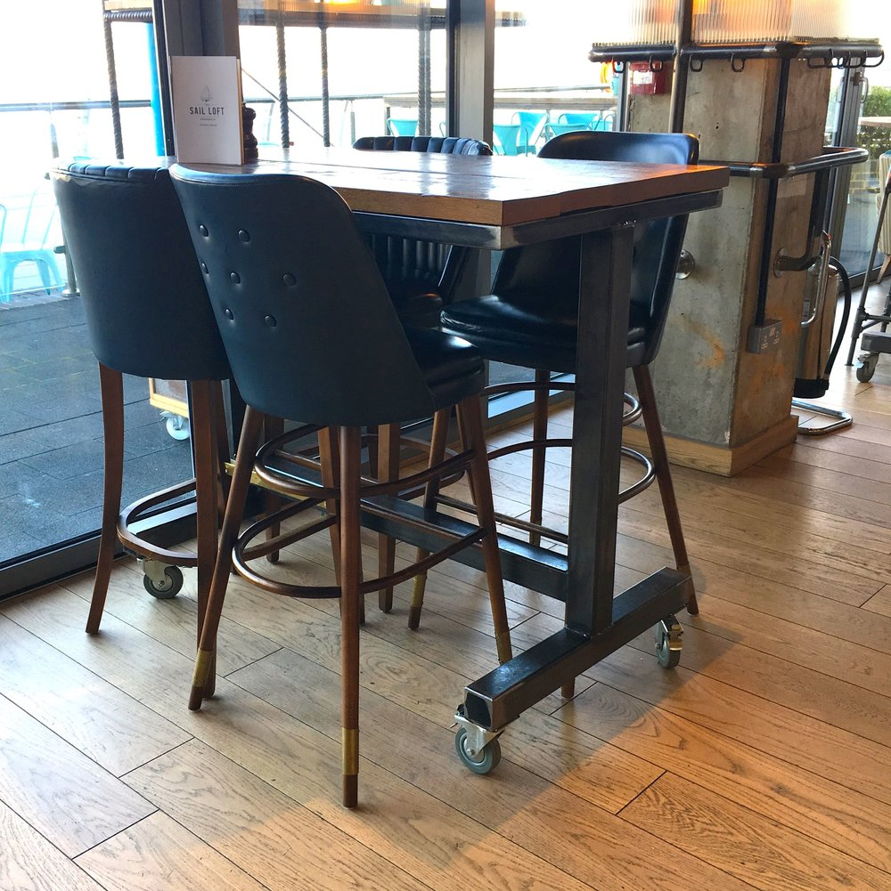 High leather bar stools complement the industrial furniture