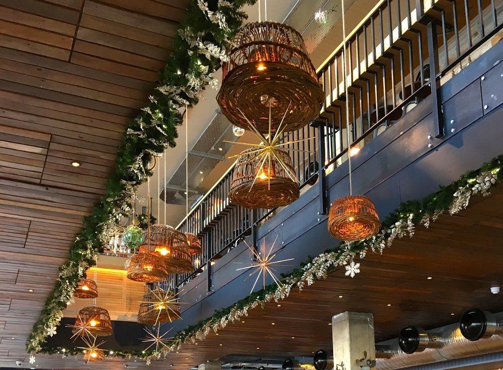 A look at the space above the bar decorated with christmas decorations and fishing memorabilia