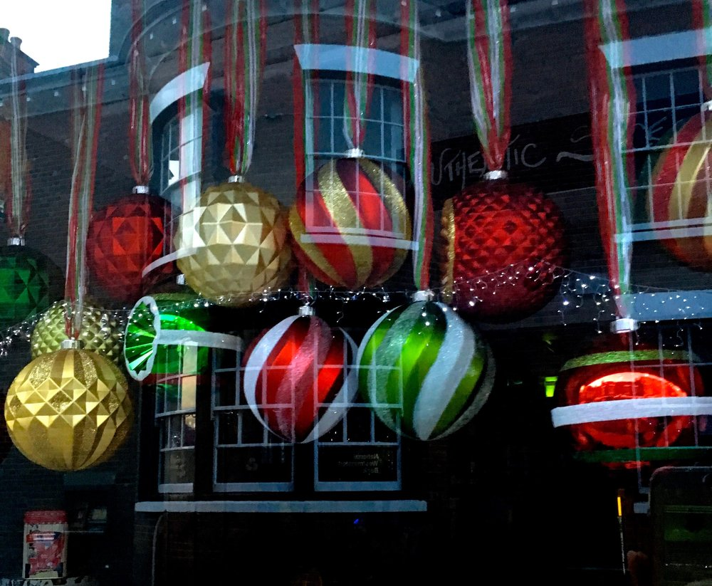 BAUBLES AND REFLECTIONS IN A SHOP WINDOW IN RYE