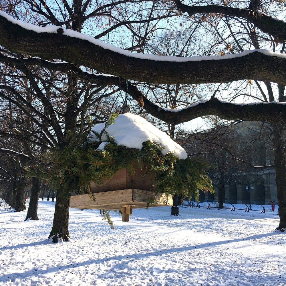 A snowy topped bird table in Munich's Hofgarten