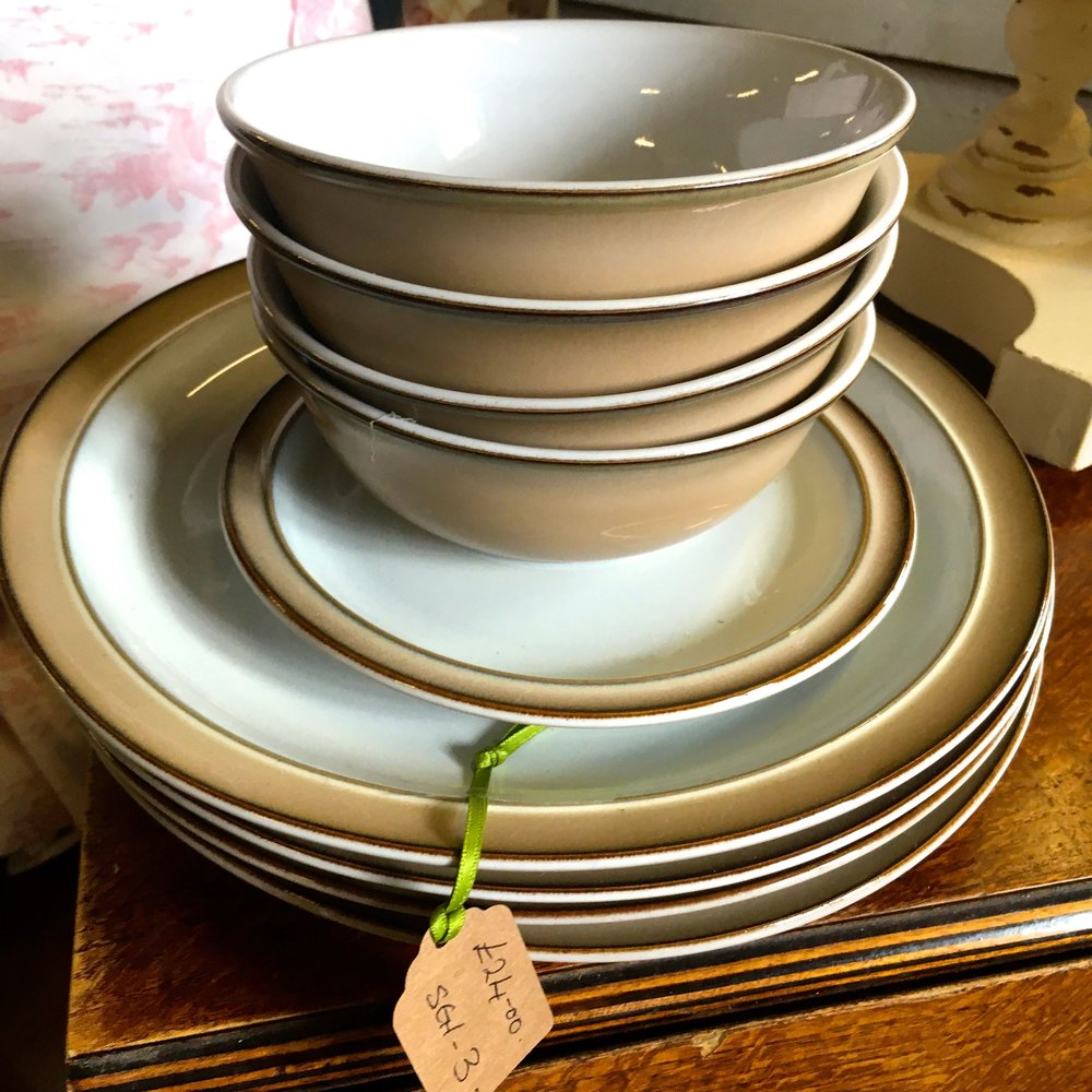 A stack of neutral dinnerware that has a timeless feel to it