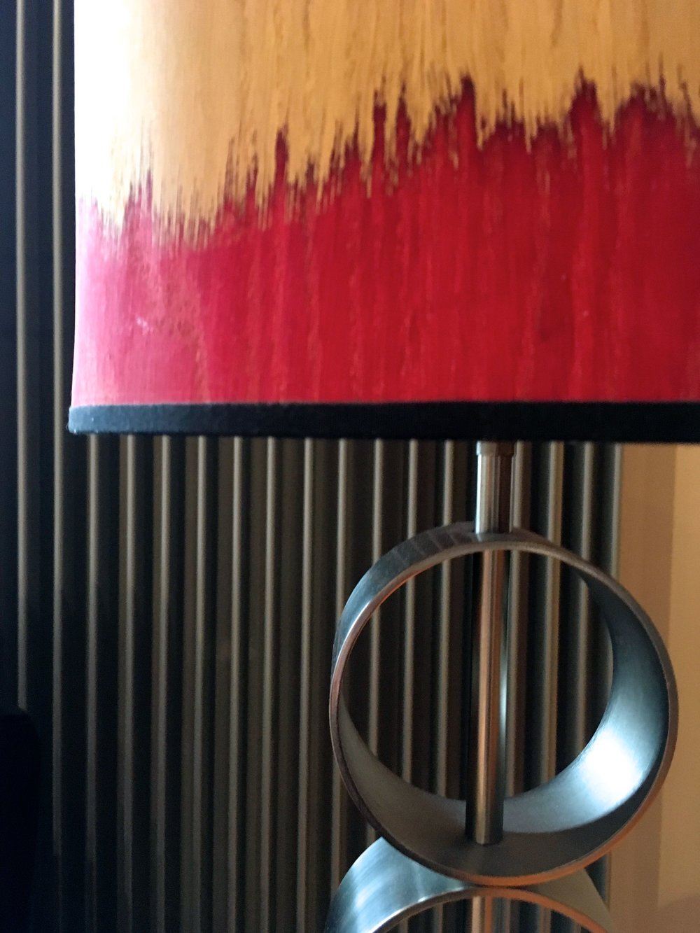 This paper lampshade adds texture with it's feathered pattern and contrasts with the lamp base and the radiator breaking it up nicely #notcompletewithout
