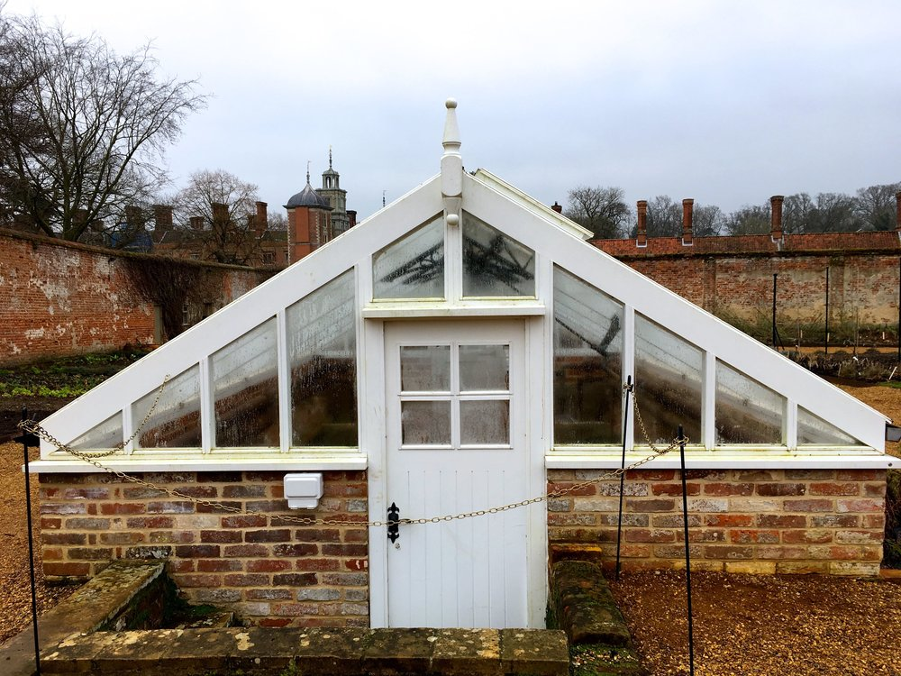 traditional Glasshouses in the kitchen garden at Blickling NT
