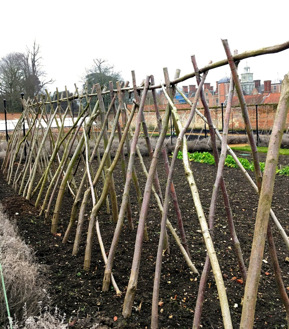 plant supports ready and waiting in the walled kitchen garden at Blickling