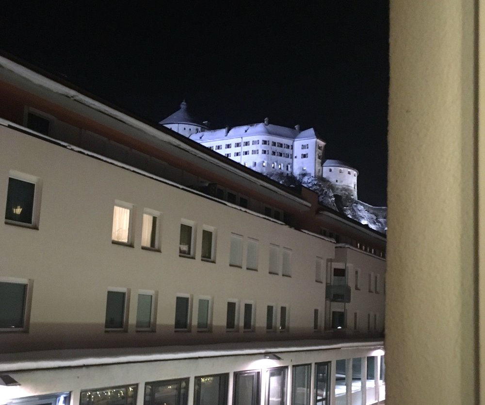 The view out of the window at night towards the Fortress at Kufstein