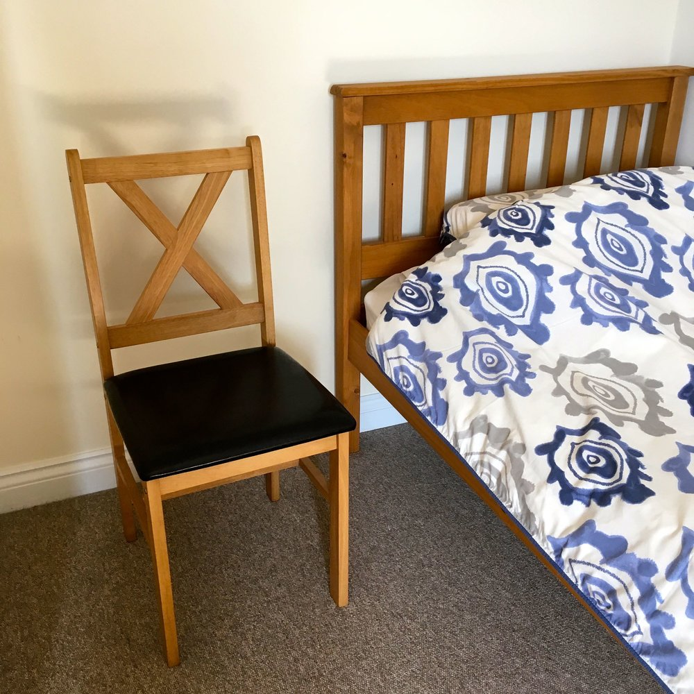 An extra bed and a chair