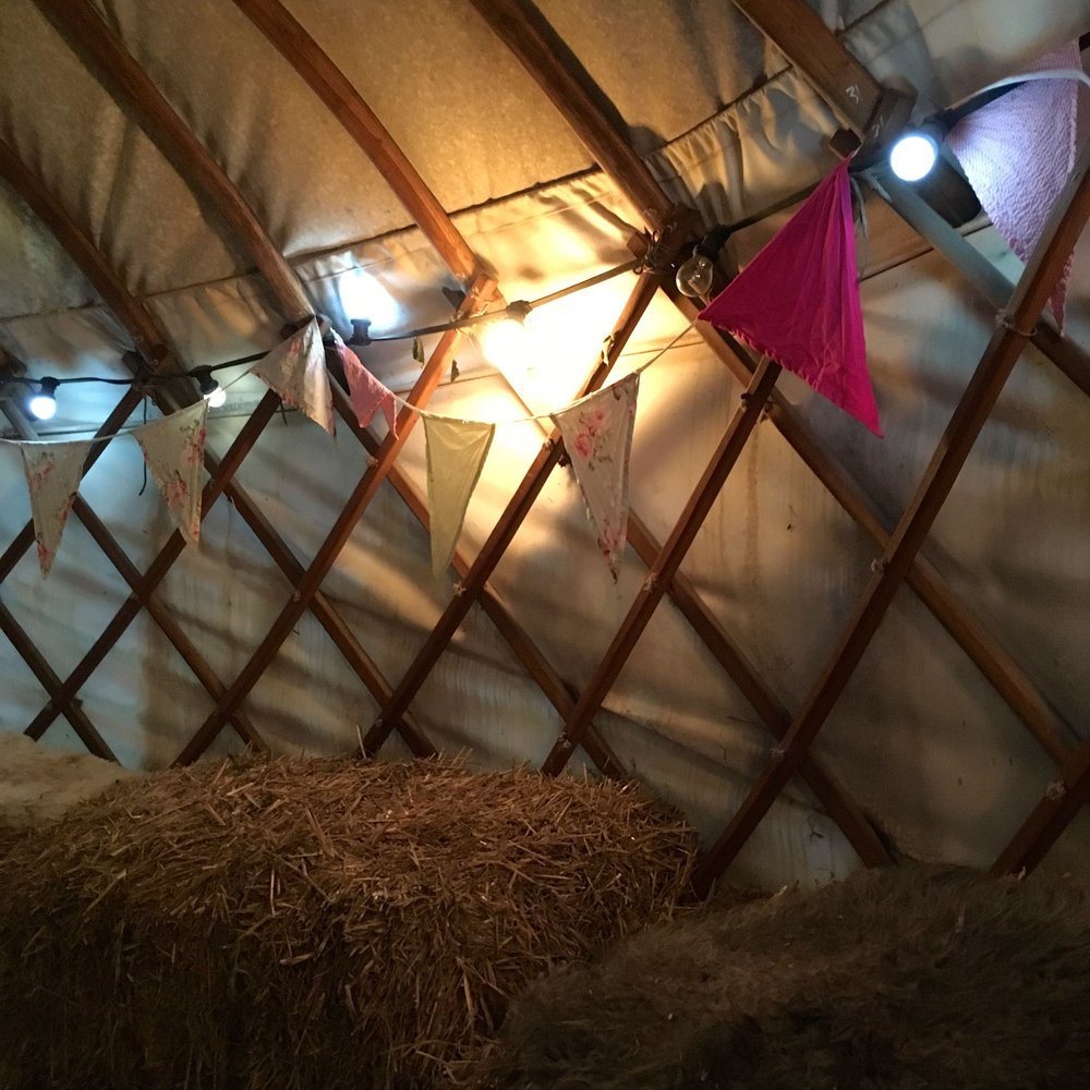 Bunting in the yurt above the straw bales at River Cottage HQ