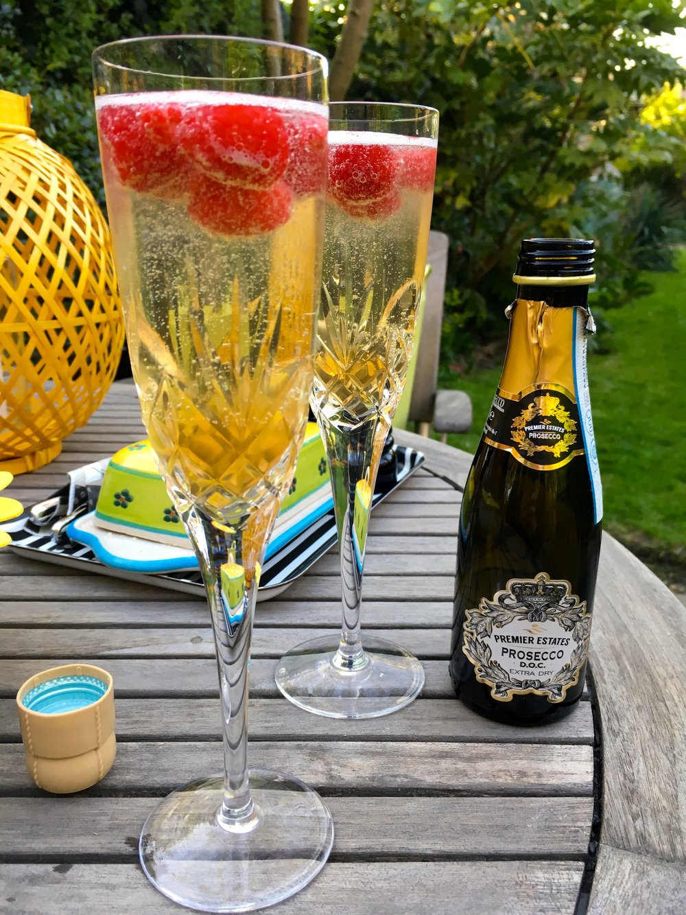 Enjoying an aperitif - prosecco from premier estates wine, elderflower liqueur and frozen raspberries grown on our allotment