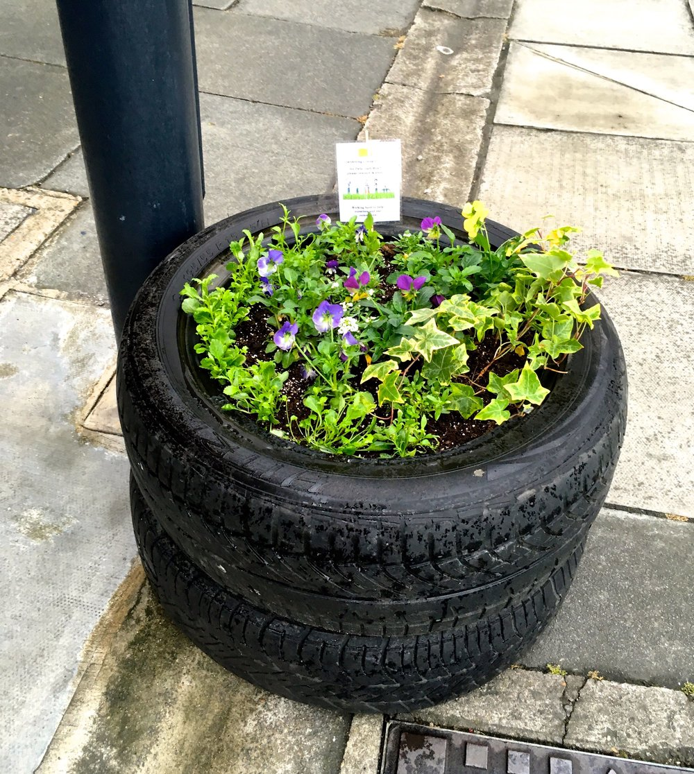 TYRES AS A PLANTER OUTSIDE THE GARAGE