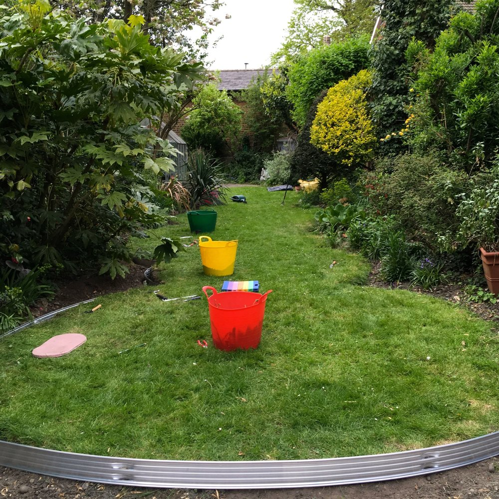 a look up the garden with my traffic light garden trugs