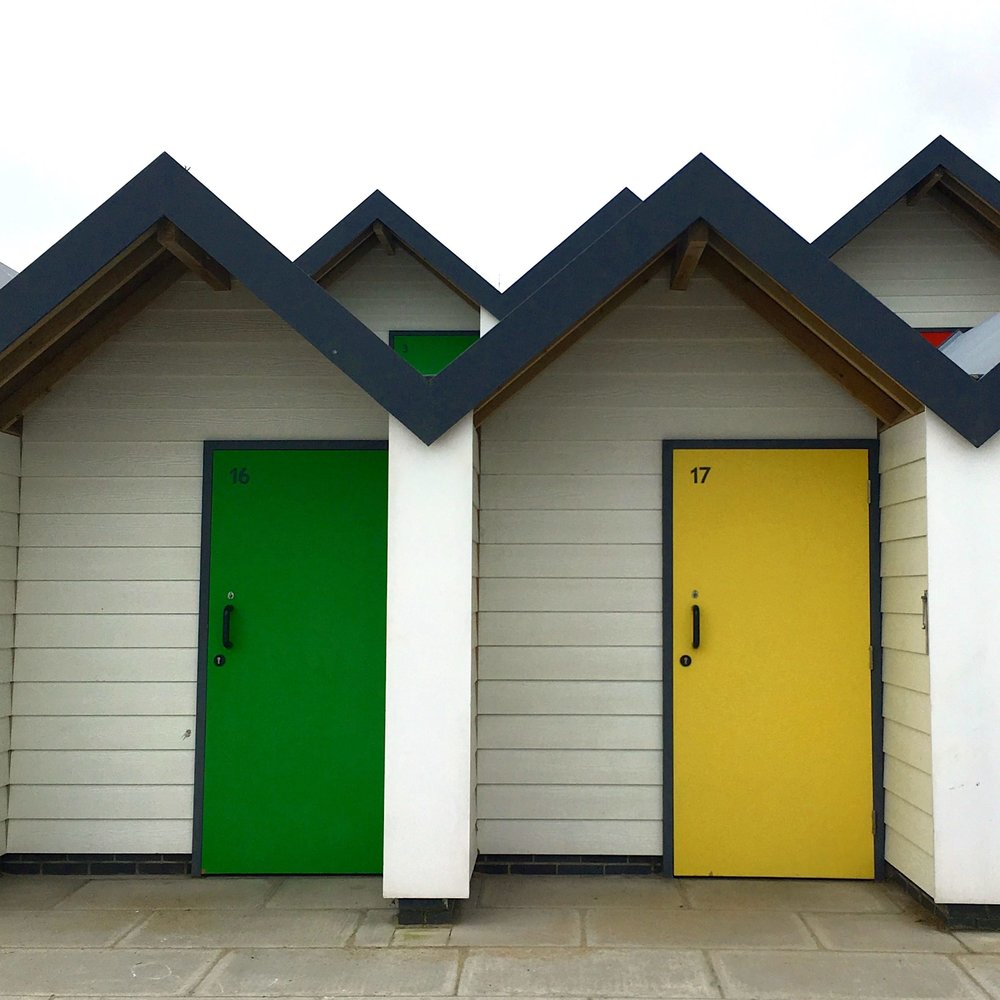 modern beach huts on the front at Swanage in Dorset