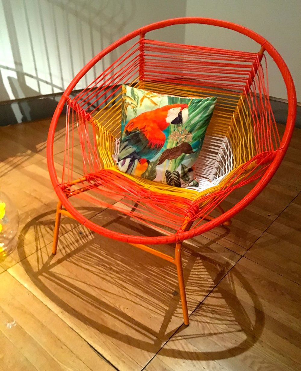 how about a circular chair, with that parrot I was talking about