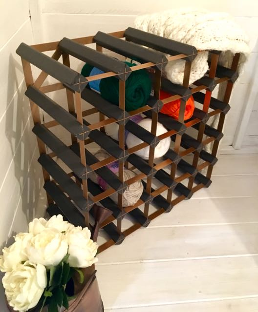 A novel use for a wine rack - but not sure it'll catch on!