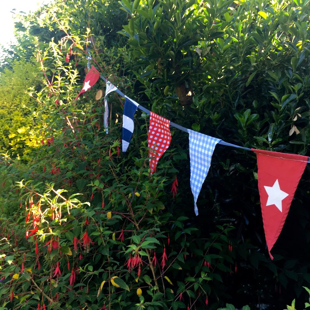 shop-bought bunting hanging ship-shape in the garden