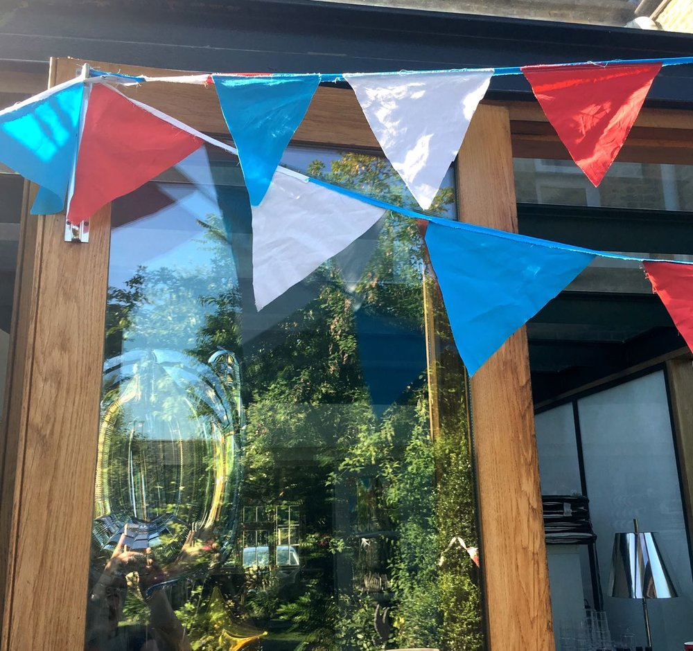 mum's patriotic bunting hung above our conservatory doors