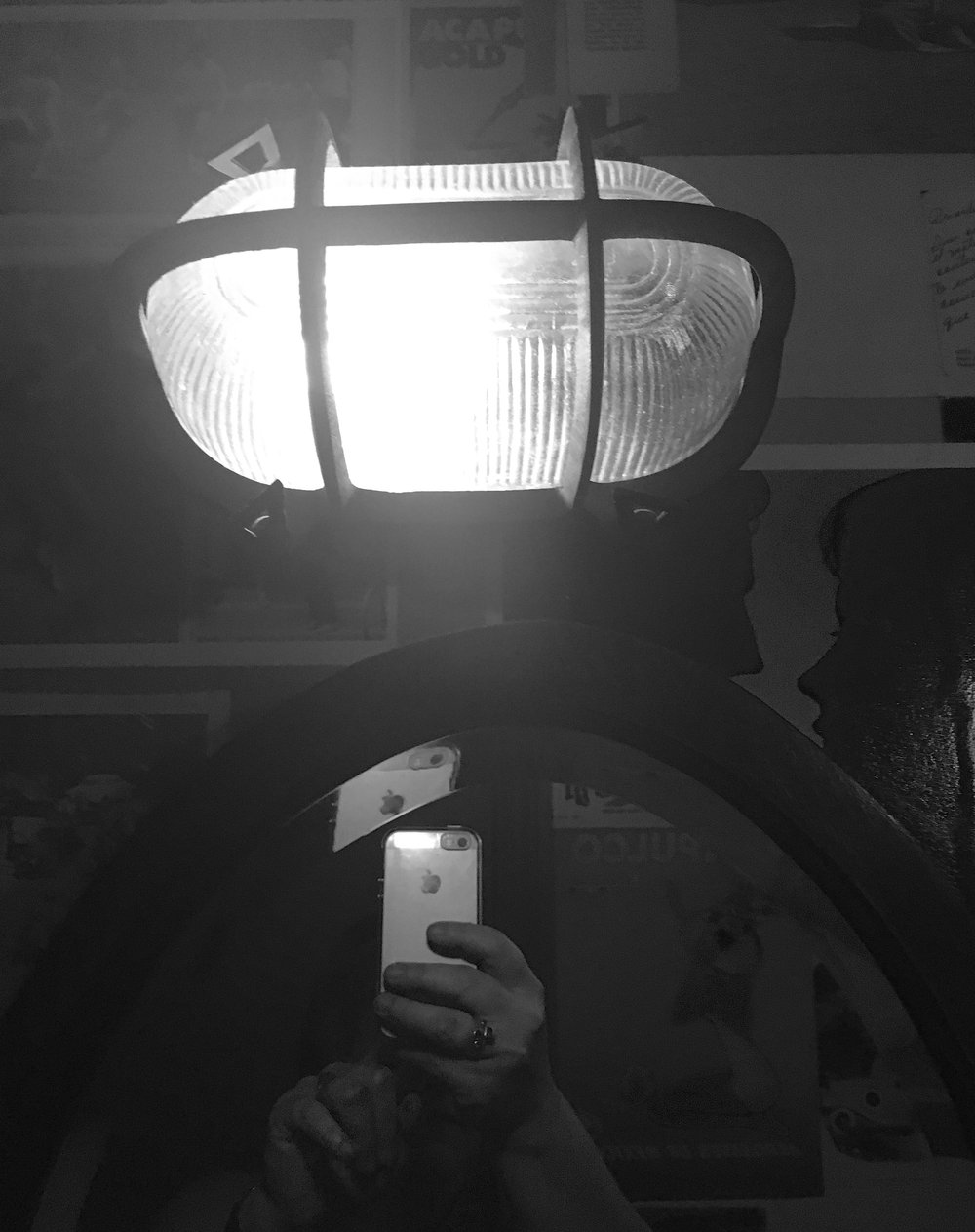 The same style light is above the mirror too