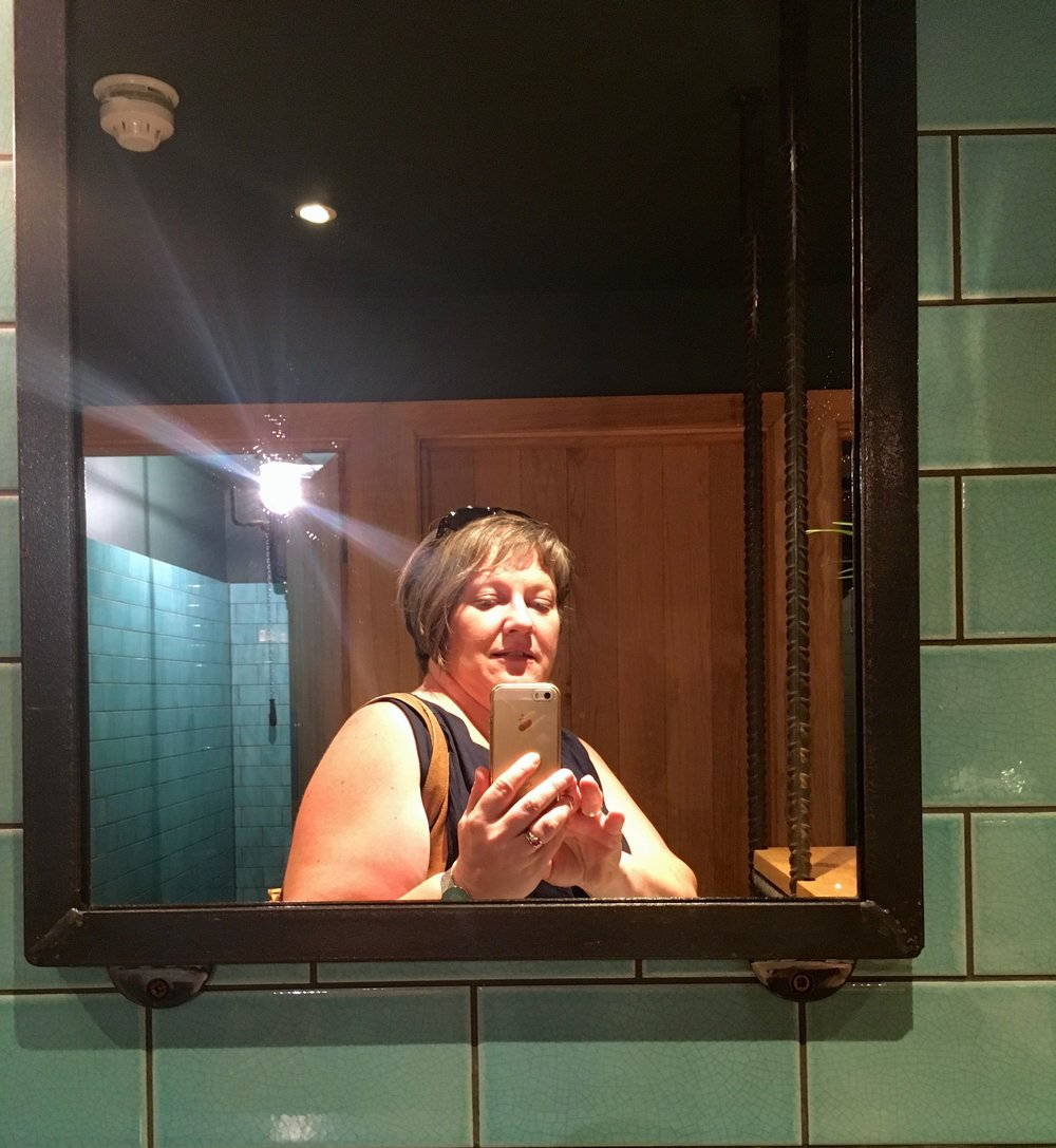 Mirrors, flowers, plenty of space and a space that looks great in the ladies toilet at The Sail Loft in Greenwich
