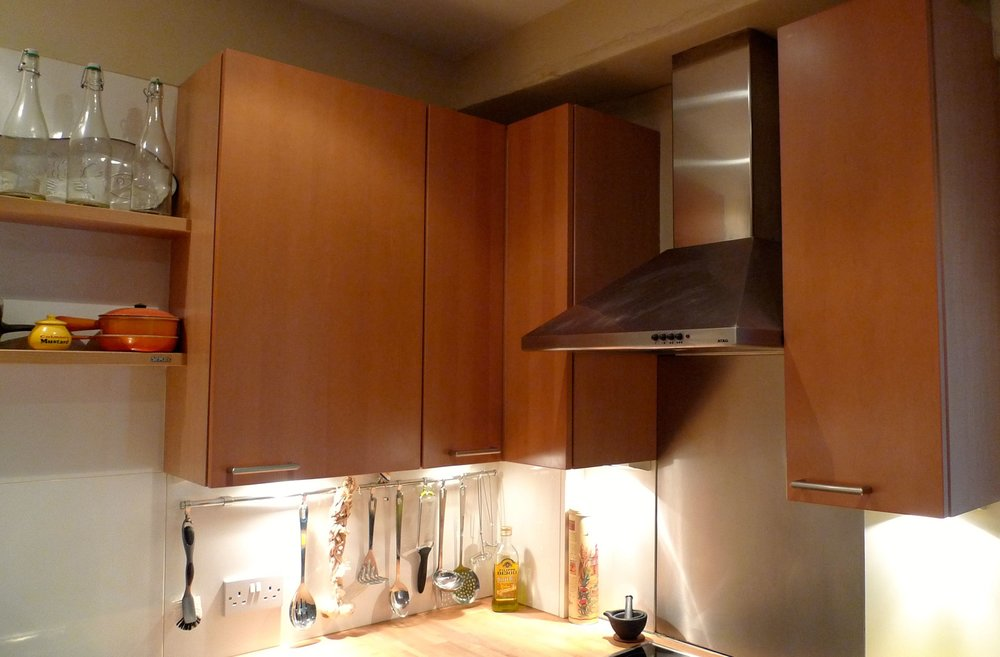 Cherry wood wall units and the chrome cooker hood