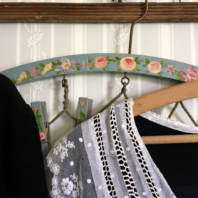 STRIPED WALLPAPER AND A PRETTY FLORAL HANGER IN THE MAIDS ROOM AT MOTTISFONT