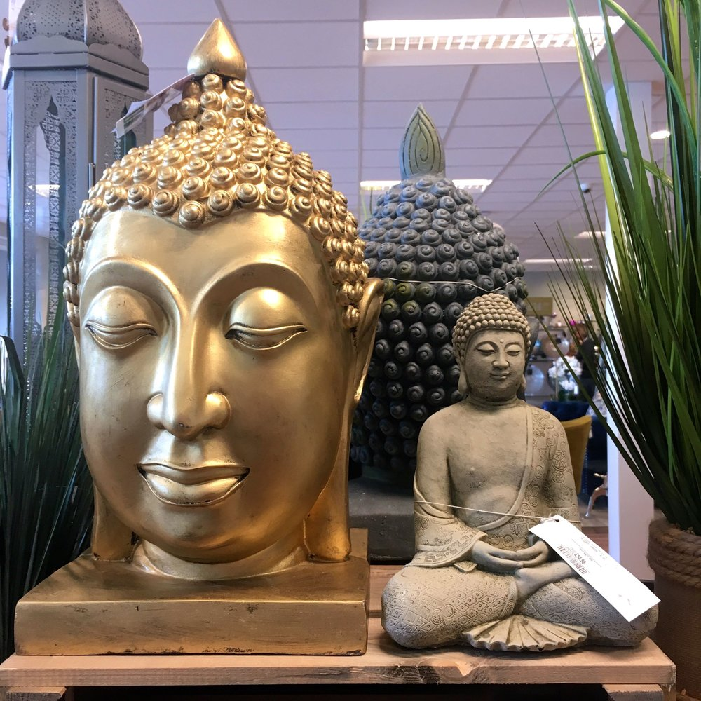 Calming buddhas among the cushion frenzy in the new HomeSense store at Greenwich