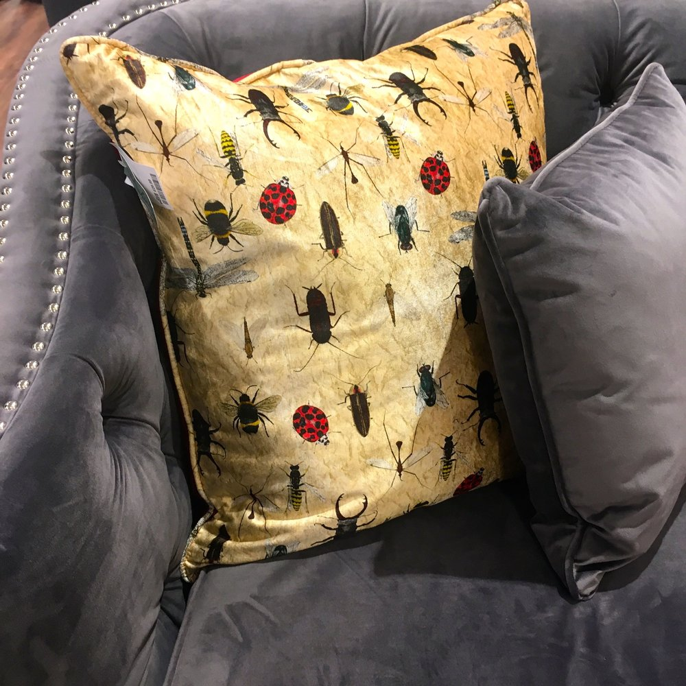 Another grey and yellow sofa and cushion combo at the new HomeSense store in Greenwich