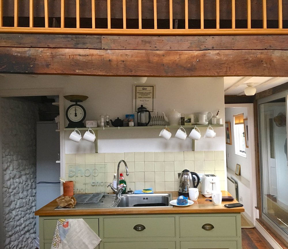 A pretty double height kitchen at Oak Hill Granary in Fressingfield