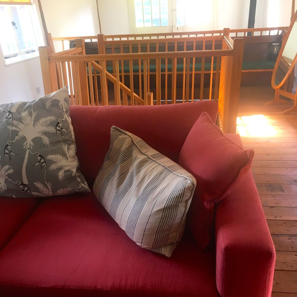 homely sofas with great cushions upstairs at Oak Hill Granary in Fressingfield
